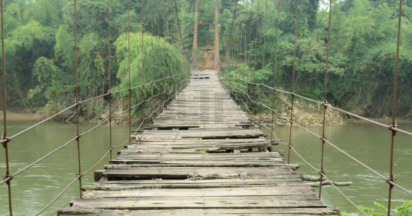 A rope bridge crossing a chasm.